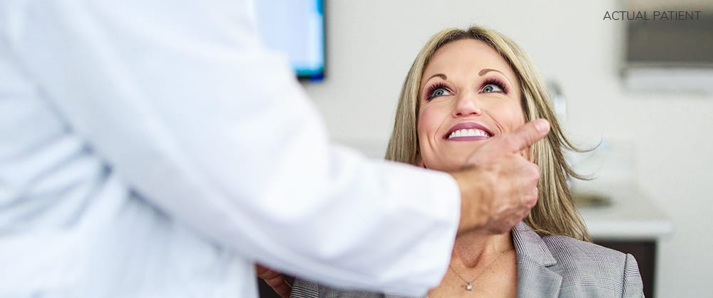 Actual Patient Smiling Up at Doctor